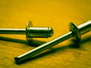 Three rivets laying on a table